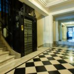 "Marble lobby with ""Cabaret"" elevator"